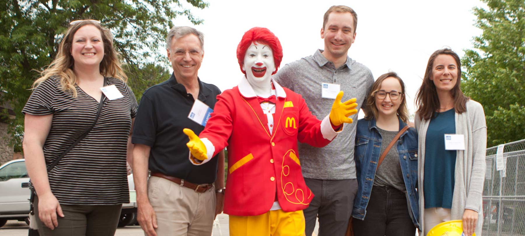 CEO Jeff Zutz and Flad Team with Ronald McDonald | Flad Architects
